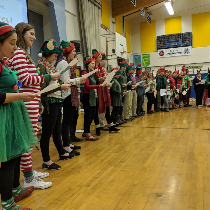 Elves singing a teacher edition of Jingle Bells