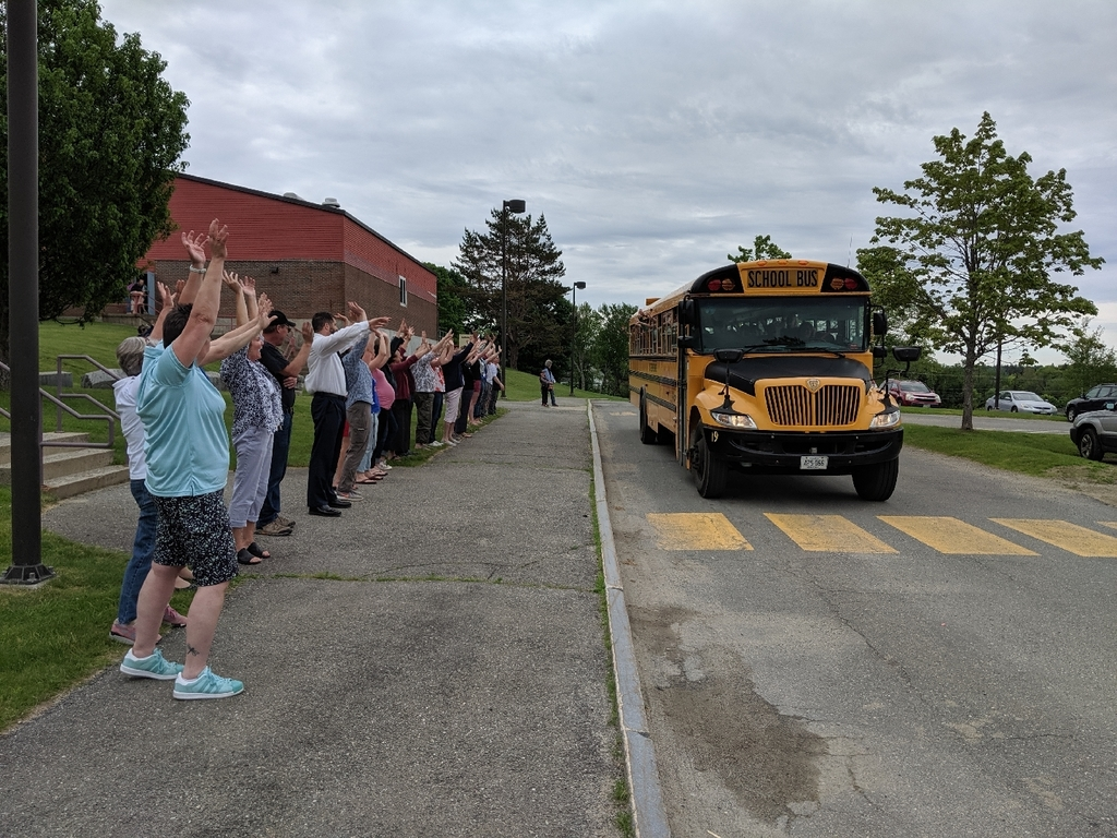 Staff saying goodbye to the students on the last day of school